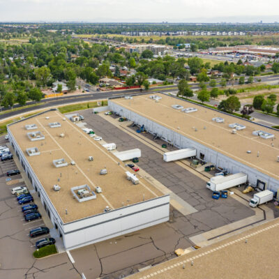 Aerial photo of light-industrial property Commerce Square, showing truck bays, parking, and surrounding trees