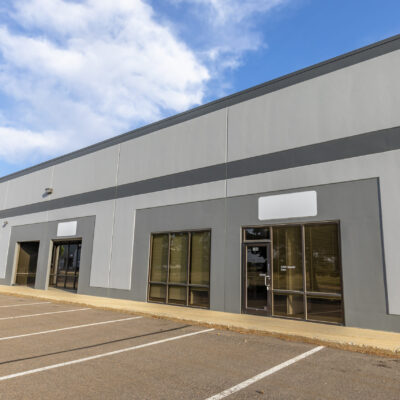 Storefronts with drive-up parking at light-industrial property Commerce Square